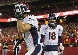 Photo - Denver Broncos quarterback Peyton Manning (18) congratulates wide receiver Eric Decker (87) for a touchdown reception during the second half of an NFL football game against the Kansas City Chiefs, Sunday, Dec. 1, 2013, in Kansas City, Mo. (AP Photo/Ed Zurga)