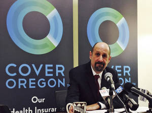 Photo - FILE - This Dec. 10, 2013, file photo shows Dr. Bruce Goldberg, acting head of Oregon's troubled health insurance exchange, at a news conference at Cover Oregon headquarters in Durham, Ore. More than five months after Oregon's botched health-insurance exchange failed to go live, concern is mounting for another, less visible state IT project that was built in conjunction with the exchange, using the same technology. Officials say they are about to launch a formal review of the so-called modernization program, a multimillion-dollar Department of Human Services project meant to improve online access to public benefits, to see if it hides serious flaws similar to those of the Cover Oregon exchange. (AP Photo/Gosia Wozniacka, File)