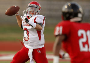 Photo - Carl Albert's Stevie Thompson throws a pass during a high school football scrimmage between Del City and Carl Albert in Del City, Okla., Friday, August 23, 2013. Photo by Bryan Terry, The Oklahoman
