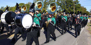 Photo - Norman North High School's marching band performs with the Norman High School marching band at a Veterans Day parade. OKLAHOMAN ARCHIVES <strong>PAUL B. SOUTHERLAND</strong>