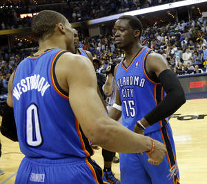Photo - Oklahoma City's Reggie Jackson (15) becomes emotional as Oklahoma City's Russell Westbrook (0) approaches him after Game 4 in the first round of the NBA playoffs between the Oklahoma City Thunder and the Memphis Grizzlies at FedExForum in Memphis, Tenn., Saturday, April 26, 2014. Photo by Bryan Terry, The Oklahoman