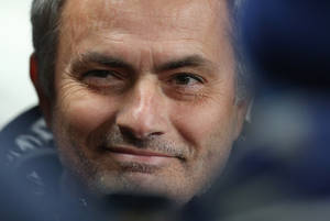 Photo - Chelsea's manager Jose Mourinho smiles as he waits for the English Premier League soccer match between Manchester City and Chelsea at the Etihad Stadium, Manchester, England, Monday, Feb. 3, 2014. (AP Photo/Jon Super)
