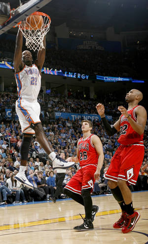 photo - Oklahoma CIty's Jeff Green dunks the ball over Chicago's Kyle Korver, center, and Taj Gibson during the NBA basketball game between the Oklahoma City Thunder and the Chicago Bulls in the Oklahoma City Arena on Wednesday, Oct. 27, 2010. Photo by Bryan Terry, The Oklahoman