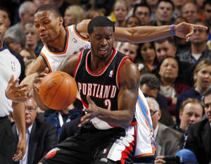 photo - Oklahoma City's Russell Westbrook (0) tries to steal the ball from Wesley Matthews (2) of Portland in the first half during the NBA basketball game between the Oklahoma City Thunder and Portland Trail Blazers at Chesapeake Energy Arena in Oklahoma City, Tuesday, Jan. 3, 2012. Photo by Nate Billings, The Oklahoman