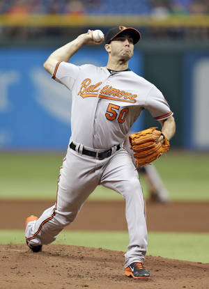 Photo - Baltimore Orioles starting pitcher Miguel Gonzalez delivers to Tampa Bay Rays' David DeJesus during the first inning of a baseball game Saturday, Sept. 21, 2013, in St. Petersburg, Fla. (AP Photo/Chris O'Meara)