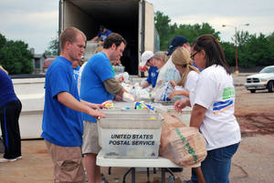 Photo - Volunteers sort through donated food during a previous Feeding Hope and Letter Carriers Food Drive. Postal workers will be collecting donated food items on May 11 for distribution to the Regional Food Bank.   <strong>PROVIDED - PROVIDED</strong>