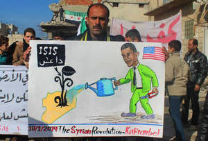 "Photo - In this citizen journalism image provided by Edlib News Network, ENN, which has been authenticated based on its contents and other AP reporting, a protester holds a placard depicting U.S. President Barack Obama during a demonstration in Kafr Nabil town, Idlib province, northern Syria, Friday, Jan. 10, 2014. Rebel-on-rebel fighting between an al-Qaida-linked group and an array of more moderate and ultraconservative Islamists has killed nearly 500 people over the past week in northern Syria, an activist group said Friday, in the most serious bout of violence among opponents of Syrian President Bashar Assad since the civil war began. The Arabic on the poster is an acronym meaning, ""the Islamic State of Iraq and the Levant."" (AP Photo/Edlib News Network ENN)"