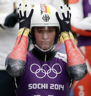 Photo - Natalie Geisenberger of Germany prepares to start her run during a training session for the women's singles luge at the 2014 Winter Olympics, Thursday, Feb. 6, 2014, in Krasnaya Polyana, Russia. (AP Photo/Michael Sohn)