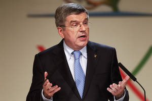 Photo - Thomas Bach, of Germany, speaks after being named the new president of the International Olympic Committee (IOC) during the 125th IOC session in Buenos Aires, Argentina, Tuesday, Sept. 10, 2013. (AP Photo/Victor R. Caivano)