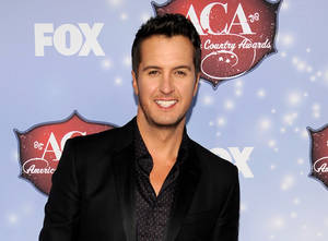 Photo - FILE - This Dec. 10, 2013 file photo shows Luke Bryan at the American Country Awards at the Mandalay Bay Resort & Casino in Las Vegas, Nev. Bryan announced the stadium shows in Pittsburgh in June and Philadelphia and Chicago in August during a news conference Tuesday, Jan 14, 2014. Bryan said he's stepping everything up as he heads into just his second headlining tour of about 80 dates. (Photo by Chris Pizzello/Invision/AP, File)