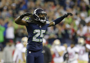 Photo - Seattle Seahawks' Richard Sherman celebrates after the Seahawks score a safety in the first half of an NFL football game against the San Francisco 49ers, Sunday, Sept. 15, 2013, in Seattle. (AP Photo/Elaine Thompson)
