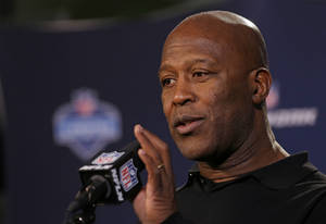 Photo - Tampa Bay Buccaneers head coach Lovie Smith answers a question during a news conference at the NFL football scouting combine in Indianapolis, Thursday, Feb. 20, 2014. (AP Photo/Michael Conroy)