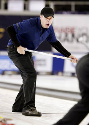 Photo - John Shuster shouts out to the Team Shuster members as they play against Team Fenson at the U.S. Olympic curling trials Saturday, Nov. 16, 2013, in Fargo, N.D. (AP Photo/The Forum, Dave Wallis)