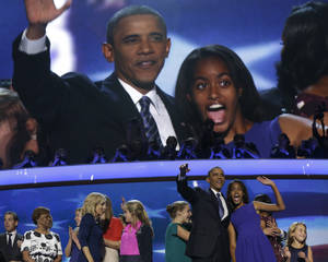 Photo -   President Barack Obama and his daughter Malia wave after President Obama's speech to the Democratic National Convention in Charlotte, N.C., on Thursday, Sept. 6, 2012. (AP Photo/Charles Dharapak)