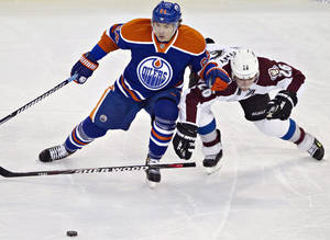 photo - Edmonton Oilers&#039; Nail Yakupov, left, battles for the puck with Colorado Avalanche&#039;s Paul Stastnyduring the second period of their NHL hockey game, Monday, Jan. 28, 2013, in Edmonton, Alberta. (AP Photo/The Canadian Press, Jason Franson)