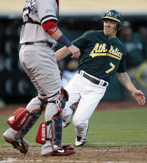 Photo -   Oakland Athletics' Brandon Inge (7) slides into home plate to score a run past Boston Red Sox catcher Jarrod Saltalamacchia (39) in the third inning of a baseball game Saturday, Sept. 1, 2012 in Oakland, Calif. (AP Photo/ Tony Avelar)
