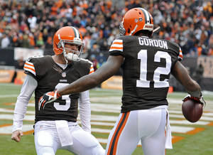 Photo - Cleveland Browns quarterback Brandon Weeden (3) celebrates with wide receiver Josh Gordon (12) after they connected on a 21-yard touchdown pass against the Jacksonville Jaguars in the second quarter of an NFL football game on Sunday, Dec. 1, 2013, in Cleveland. (AP Photo/David Richard) <strong>David Richard</strong>