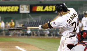 Photo -   Pittsburgh Pirates' Pedro Alvarez (24) hits a double in the fifth inning of the baseball game against the St. Louis Cardinals on Wednesday, Aug. 29, 2012, in Pittsburgh. Alvarez hit a three-run homer earlier, and then later scored after this double as the Pirates won 5-0. (AP Photo/Keith Srakocic)