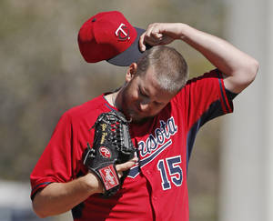 Photo - Minnesota Twins relief pitcher Glen Perkins (15) reacts  during the fourth inning of a spring training baseball game against the Toronto Blue Jays in Dunedin, Fla., Saturday, March 8, 2014.  (AP Photo/Kathy Willens)