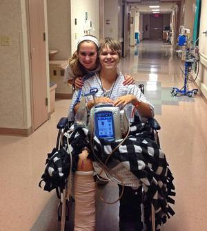 Photo - In September, Alex Boyd, 17, was severely injured in a car accident. He received up to three units of blood a day while enduring 15 surgeries at OU Medical Center, including the amputation of his right leg below the knee. He is pictured with his sister, Emily Boyd, 16. <strong></strong>