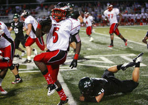 Photo - Del City's Greg Johnson (5) weaves his way through the Norman North defense on a long touchdown catch and run in high school football at Harve Collins Field on Thursday, Sept. 9, 2010, in Norman, Okla.  Photo by Steve Sisney, The Oklahoman