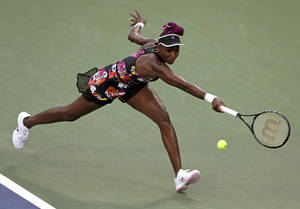 Photo - Venus Williams lunges for a shot against Jie Zheng, of China, during the second round of the 2013 U.S. Open tennis tournament, Wednesday, Aug. 28, 2013, in New York. (AP Photo/Charles Krupa)