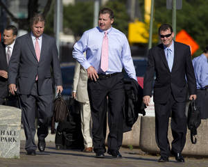 Photo -   Former Major League Baseball pitcher Roger Clemens, center, arrives at federal court in Washington, Tuesday, May 29, 2012, for his perjury trial. (AP Photo/Evan Vucci)
