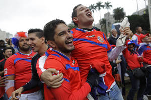 Photo - Costa Rica soccer fans celebrates a goal as they watch the Italy vs. Costa Rica World Cup match inside the FIFA Fan Fest area in Sao Paulo, Brazil, Friday, June 20, 2014. (AP Photo/Nelson Antoine)