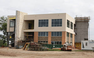 Photo - The new Oklahoma Independent Petroleum Association building is shown Thursday under construction at NE 4 and Lincoln in Oklahoma City.  Photo By Steve Gooch, The Oklahoman