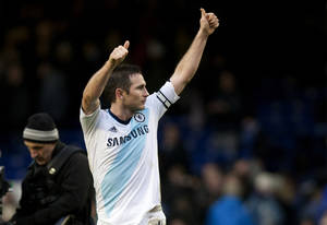 photo - Chelsea's Frank Lampard celebrates after his team's 2-1 win against Everton during their English Premier League soccer match at Goodison Park Stadium, Liverpool, England, Sunday Dec. 30, 2012. Lampard scores both his team's goals. (AP Photo/Jon Super)