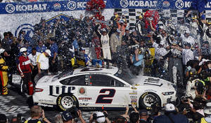 Photo - Brad Keselowski celebrates in victory lane after winning a NASCAR Sprint Cup Series auto race, Sunday, March 9, 2014, in Las Vegas. (AP Photo/Isaac Brekken)