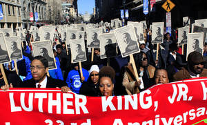 Photo - Participants march down Fayetteville Street in Raleigh, N.C., Monday, Jan. 21, 2013, during the 33rd annual Dr. Martin Luther King Jr. parade. (AP Photo/The News & Observer, Travis Long)