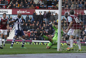 Photo - West Bromwich Albion's Nicolas Anelka, second left, scores his second goal against West Ham United, during their English Premier League soccer match at Upton Park, London, Saturday, Dec. 28, 2013. (AP Photo/Sang Tan)