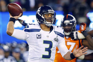 Photo - Seattle Seahawks' Russell Wilson throws against the Seattle Seahawks during the second half of the NFL Super Bowl XLVIII football game Sunday, Feb. 2, 2014, in East Rutherford, N.J. (AP Photo/Paul Sancya)