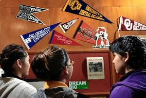 photo - Seniors at  Santa  Fe South  High School in Oklahoma City consider college opportunities while visiting the school counselor's office Tuesday, sept. 28, 2010. Additional barriers exist for children of undocumented parents when it comes to applying for and paying for college. Photo by Jim Beckel, The Oklahoman