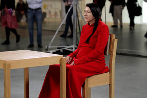 "Photo -   In this 2010 photo released by Rio Film Festival, performance artist Marina Abramovic sits during the making of documentary film ""Marina Abramovic:The Artist is Present"" in New York's Museum of Modern Art. The Belgrade-born artist is best known for this piece which in 2010 saw her sit silent and motionless for 736.5 hours opposite a parade of strangers. The film is playing at the 2012 Rio de Janeiro International Film Festival. (AP Photo/Rio Film Festival)"