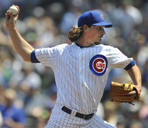 Photo - Chicago Cubs starter Jeff Samardzija delivers a pitch during the first inning of an interleague baseball game against the New York Yankees in Chicago, May 21, 2014. (AP Photo/Paul Beaty)