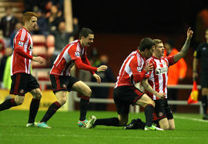 photo - Sunderland's James McClean, right, celebrates his goal with his teammates during their English Premier League soccer match against Reading at the Stadium of Light, Sunderland, England, Tuesday, Dec. 11, 2012. (AP Photo/Scott Heppell)