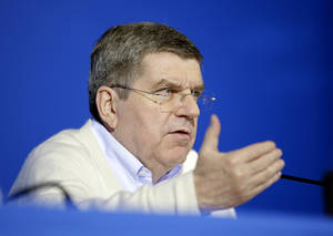 Photo - International Olympic Committee President Thomas Bach speaks during a press conference at the 2014 Winter Olympics, Monday, Feb. 3, 2014, in Sochi, Russia. (AP Photo/David Goldman)
