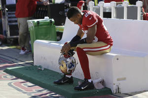 Photo - San Francisco 49ers cornerback Nnamdi Asomugha (28) sits on the bench during the fourth quarter of an NFL football game against the Indianapolis Colts in San Francisco, Sunday, Sept. 22, 2013. The Colts won 27-7. (AP Photo/Marcio Jose Sanchez)