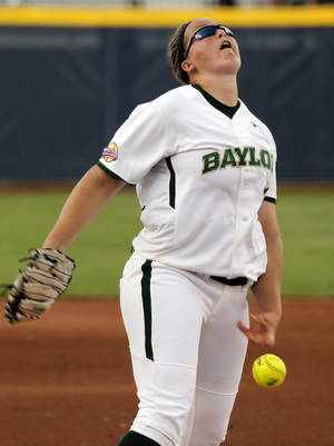 Photo - Baylor's Whitney Canion pitches during the Women's College World Series softball tournament game between Baylor and Kentucky at ASA Hall of Fame Stadium on Saturday, May 31, 2014 in Oklahoma City, Okla.  Photo by Steve Sisney, The Oklahoman
