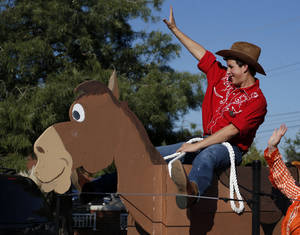Photo - Matthew Strait waves from a float during the Edmond North homecoming parade. Photo by Sarah Phipps, The Oklahoman <strong>SARAH PHIPPS - SARAH PHIPPS</strong>