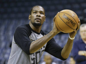 Photo - Oklahoma City Thunder forward Kevin Durant shoots during practice Friday, April 25, 2014, in Memphis, Tenn. The Thunder face the Memphis Grizzlies on Saturday in Game 4 of their opening-round NBA basketball playoff series. The Grizzlies lead the series 2-1. (AP Photo/Mark Humphrey)