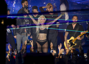Photo - Lady Gaga performs at Stubb's in Austin, Texas, during the South by Southwest Music Festival on Thursday March 13, 2014.   (AP Photo/Austin American-Statesman, Jay Janner)