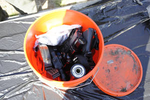 Photo - This undated photo provided by the FBI shows a Home Depot bucket containing gun parts, ammunition and other items discovered at a Parishville, N.Y. reservoir after a man jailed in Alaska admitted to a series of killings, including an Anchorage barista and a couple from Vermont. (AP Photo/FBI)