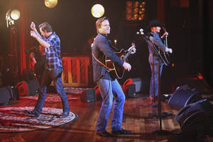 """Photo - This image released by ABC shows, from left, Will Chase, Charles Esten and Chris Carmack performing on a special """"Nashville: On the Record,"""" episode at the Ryman Auditorium, in Nashville, Tenn. All original music from the show is released by ABC Studios, Lionsgate and ABC Music Lounge in association with Big Machine Records. Now is a nerve-jangling time for actors and creators of television shows, one week before the biggest broadcast networks reveal their plans for next season. The wait is particularly intense for series, like """"Nashville,"""" that are considered on the bubble between returning and having the plug pulled. A thumbs-down from ABC not only ends a televised soap opera, but a growing music franchise as well. (AP Photo/ABC, Mark Levine)"""