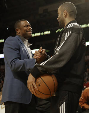 Photo - Actor Chris Tucker, left and West Team's Tony Parker, of the San Antonio Spurs speak before the NBA All Star basketball game, Sunday, Feb. 16, 2014, in New Orleans. (AP Photo/Gerald Herbert)