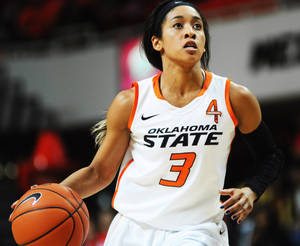 Photo - Oklahoma State guard Tiffany Bias dribbles through the lane the Oklahoma State womens' basketball season opener game versus Lamar on Nov. 8, 2013 at Gallagher Iba Arena in Stillwater, Okla. Photo by KT King/For the Oklahoman
