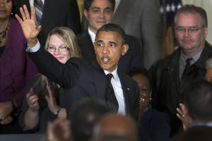 Photo -   President Barack Obama waves as he leaves the East Room of the White House in Washington, Friday, Nov. 9, 2012, after he spoke about the economy and the deficit. (AP Photo/Carolyn Kaster)