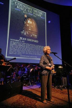 photo - Jean Shepard performs after being inducted into the Country Music Hall of Fame during the private Medallion Ceremony at The Country Music Hall of Fame and Museum in Nashville, Tenn. on Sunday, May 22, 2011. Reba McEntire, Bobby Braddock, and Jean Shepard were all inducted into the Country Music Hall of Fame. (AP Photo/Josh Anderson) &lt;strong&gt;Josh Anderson - AP&lt;/strong&gt;